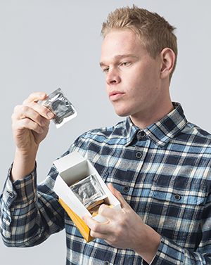 Man holding box of condoms.