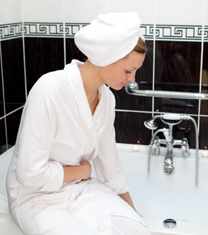 Woman preparing her bath water.